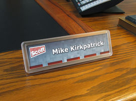 Desk name plate with clear frame